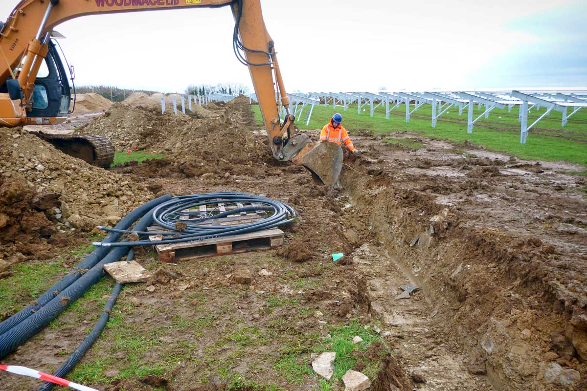 Cable trenching to the rows of the solar power plant