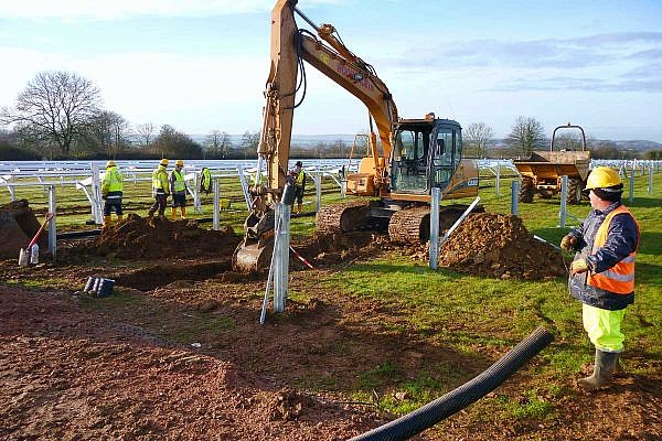 Cable installation between the rows of posts
