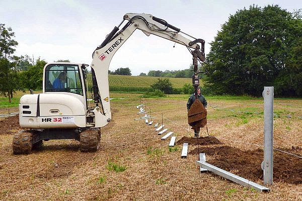 Excavator with a special drill bit